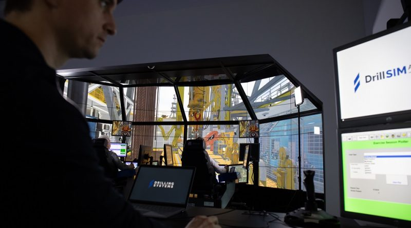 Petroleum engineers undertaking drilling and well control training on Drilling Systems' DrillSIM:6000 drilling and well control simulator